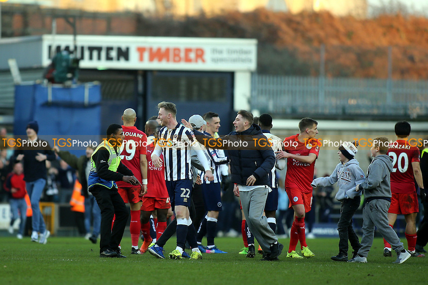 Millwall fans invade the pitch at the final whistle to celebrate their victory and congratulate the players during Millwall vs Leicester City, Emirates FA Cup Football at The Den on 18th February 2017