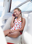 USA, Florida, St. Petersburg, Smilling girl (10-11) talking on mobile phone on yacht