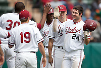 STANFORD, CA - March 27, 2011: Jake Stewart of Stanford baseball celebrates his run with the team during Stanford's game against Long Beach State at Sunken Diamond. Stanford won 6-5.