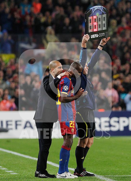 FC Barcelona's Eric Abidal (c) with the coach coach Pep Guardiola during UEFA Champions League match.May 3,2011.(ALTERPHOTOS/Acero)