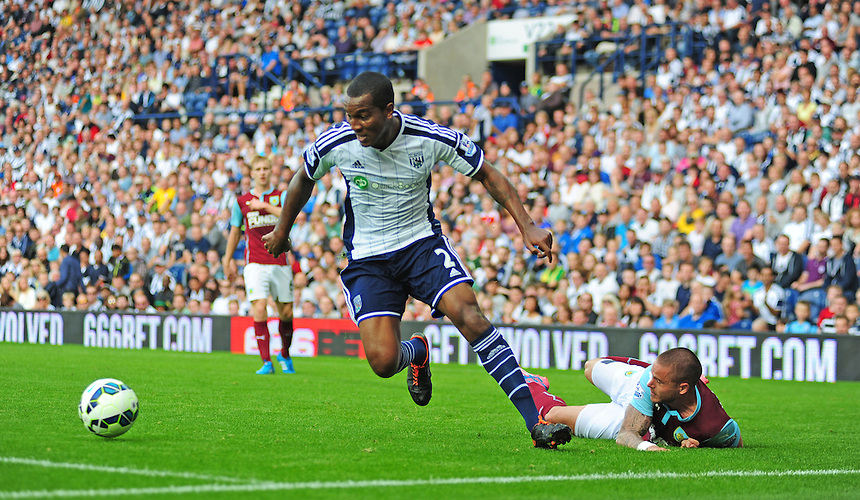 Burnley's Michael Kightly is tackled by West Bromwich Albion's Andre Wisdom<br /> <br /> Photographer Chris Vaughan/CameraSport<br /> <br /> Football - Barclays Premiership - West Bromwich Albion v Burnley - Sunday 28th September 2014 - The Hawthorns - West Bromwich<br /> <br /> &copy; CameraSport - 43 Linden Ave. Countesthorpe. Leicester. England. LE8 5PG - Tel: +44 (0) 116 277 4147 - admin@camerasport.com - www.camerasport.com