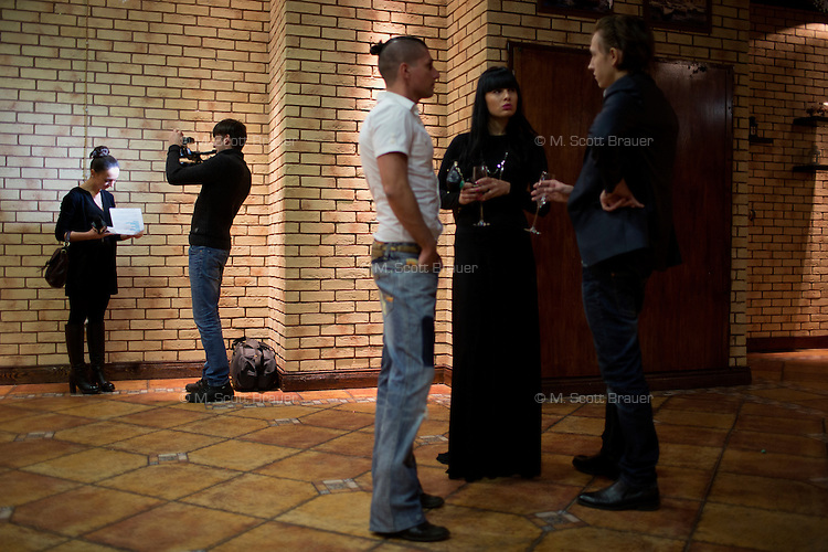 An MTV reporter and cameraman prepare to cover an art opening attended by music and television stars in Moscow, Russia.