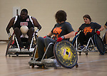 Jamal Saxton, left, and other athletes participate in the 8th Annual FourPlay! Quad Rugby Tournament in the Ping Recreation Center on Oct. 4, 2014. Photo by Lauren Pond