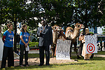 A reprsentattive from Uganda speaks to the media backdropped by a pair of camels. The camels and press conference drew attention to the severity of desertification that climate change is causing and the severity of the weak targets that countries have set at these talks. With the plodding nature of talks to date, it will be a surprise if an agreement is reached in Copenhagen later this year.  (©Robert vanWaarden)