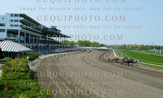 Horses enter the Clubhouse turn at Monmouth Park  in Oceanport, New Jersey.