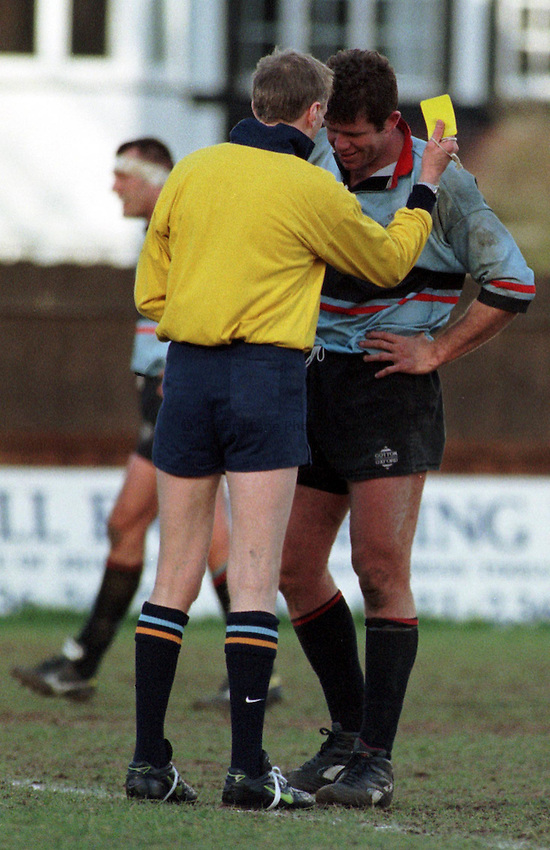 Photo. Richard Lane..David Mayhew is booked by referee T. Miller. .Moseley 29 v's Blackheath 16. 28/2/98.