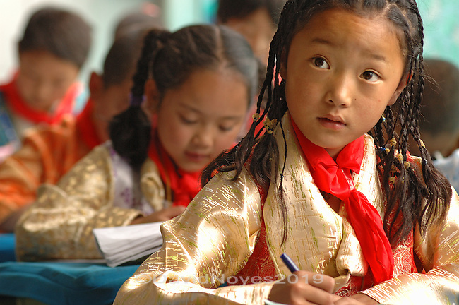 Students in national costume study at Lhasa's first elementary school. .