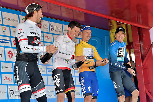 19.02.2016. Sagres, Portual.  CANCELLARA Fabian (SUI) Rider of TREK - SEGAFREDO, BENOOT Tiesj (BEL) Rider of LOTTO SOUDAL, MARTIN Tony (GER) Rider of ETIXX - QUICK STEP and THOMAS Geraint (GBR) Rider of TEAM SKY pictured during the podium ceremony after stage 3 of the 42nd Tour of Algarve cycling race, an individual time trial of 18km, with start and finish in Sagres on February 19, 2016 in Sagres, Portugal.
