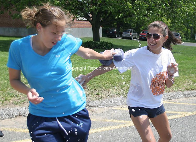 OXFORD, CT 15 May 2010 - 051510JW09.jpg -- Church members Corrin Niski and Mallori Micallefof St. Thomas the Apostle Church have a sudsey sponge fight during the church carwash fundraiser for the Annual Parrish Mission trip. This year the church will be traveling to help repair homes in need in Mifflinburg Pennsylvannia July 10-July 18. Jonathan Wilcox Republican-American