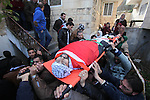 Mourners carry the body of Palestinian Jihad Khalil, who according to the Israeli police was shot and killed by an Israeli security guard after Khalil tried to stab him last November, during his funeral after Israel released his body, in the West Bank village of Beit Wazan near Nablus December 24, 2016. Photo by Nedal Eshtayah