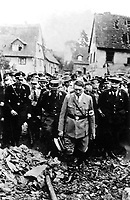 Adolf Hitler, accompanied by other German officials, grimly inspects bomb damage in a German city in 1944, in this German film captured by the U.S. Army Signal Corps on the western front. Ca. 1944.  (Army)<br /> Exact Date Shot Unknown