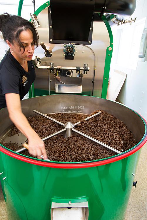 Freshly roasted coffee coming out of the roasting machine at the Ka'u Coffee Mill, in the district of Ka'u on the Big Island of Hawaii, USA, America