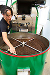 Freshly roasted coffee coming out of the roasting machine at the Ka'u Coffee Mill, in the district of Ka'u on the Big Island of Hawaii, USA, America