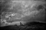 Storm/Fog over the Storr on Isle of Skye.  dark menacing clouds overhead with the famous rock formations visable.