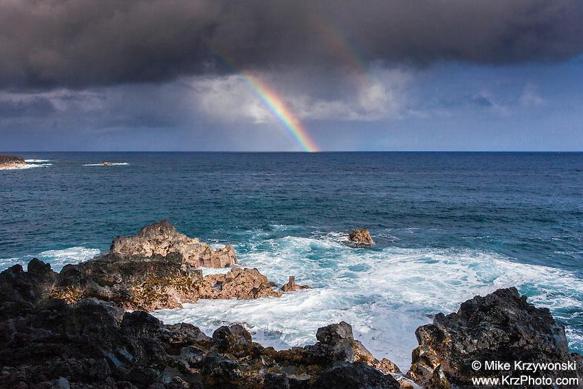 Rainbow over the ocean at Kehena Beach, Pahoa, Big Island, Hawaii