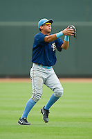Myrtle Beach Pelicans shortstop Edwin Garcia (10) makes a catch in shallow left field against the Winston-Salem Dash at BB&T Ballpark on July 7, 2013 in Winston-Salem, North Carolina.  The Pelicans defeated the Dash 4-2 in game one of a double-header.  (Brian Westerholt/Four Seam Images)