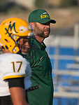 A photograph from the Manogue at McQueen football game played at McQueen High School on Friday, September 1, 2017. Manogue Coach Ernie Howren.