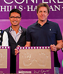 HAIKOU, CHINA - OCTOBER 28:  Hollywood actor Hugh Grant (R) of Great Britain poses with his handprints near Dr. Ken Chu (L), Vice Chairman of Mission Hills Group and during a press conference as part of the Mission Hills Star Trophy on October 28, 2010 in Haikou, China. The Mission Hills Star Trophy is Asia's leading leisure liflestyle event and features Hollywood celebrities and international golf stars. Photo by Victor Fraile / The Power of Sport Images