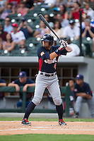 Nick Banks (4) of the US Collegiate National Team at bat against the Cuban National Team at BB&T BallPark on July 4, 2015 in Charlotte, North Carolina.  The United State Collegiate National Team defeated the Cuban National Team 11-1.  (Brian Westerholt/Four Seam Images)