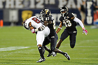 25 October 2011:  FIU defensive back Jose Cheeseborough (27) stops Troy wide receiver Jaquon Robinson (83) in the third quarter as the FIU Golden Panthers defeated the Troy University Trojans, 23-20 in overtime, at FIU Stadium in Miami, Florida.