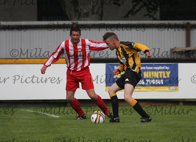 Grant Carnochan closes down Michael Fyfe in the Huntly v Wigtown & Bladnoch William Hill Scottish Cup 1st Round match, at Christie Park, Huntly on 25.8.12...