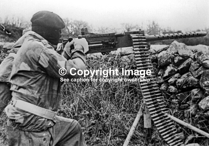 This republican movement press release photograph claims to be of a Provisional IRA border unit on manoeuvres in Co Fermanagh, N Ireland, February 1977. The volunteer in this picture is using a Browning M2 50mm machine gun. 197702130024d<br />