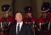 Il Presidente del Consiglio Matteo Renzi attende l'arrivo del presidente iraniano in piazza del Campidoglio, Roma, 25 gennaio 2016.<br /> Italian Premier Matteo Renzi looks up as he waits for the arrival of Iran's President in Piazza del Campidoglio to meet the Italian Premier, in Rome, 25 January 2016.<br /> UPDATE IMAGES PRESS/Riccardo De Luca