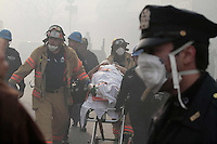 Two residential buildings explode as a result of a gas leak on Park Ave between 116th and 117th Streets, Spanish Harlem, NY Wednesday, March 12, 2014.  <br /> PICTURED:  First responders transport a woman that was trapped under rubble from the scene to a waiting ambulance.