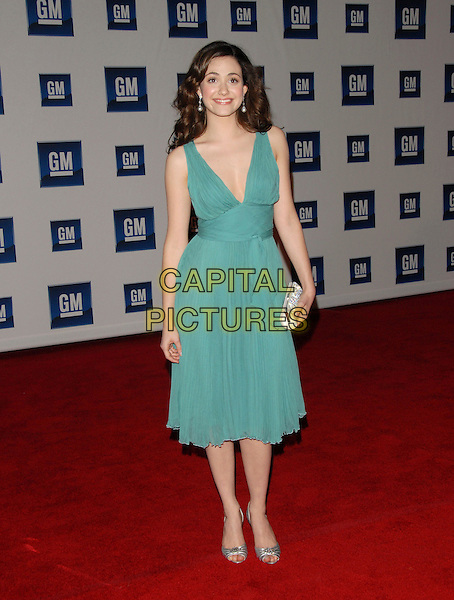 EMMY ROSSUM.The 6th Annual GM Ten Fashion Show & Concert held at Paramount Studios in Hollywood, California, USA. - Arrivals.February 20th, 2007.full length green dress silver shoes clutch purse.CAP/DVS.©Debbie VanStory/Capital Pictures