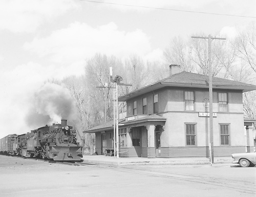 D&amp;RGW #481 and another K-36 with a double-headed westbound freight passing La Jara depot.<br /> D&amp;RGW  La Jara, CO  3/1958