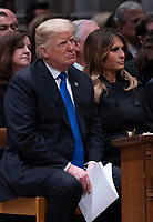 December 5, 2018 - Washington, DC, United States: United States President Donald J. Trump and First Lady Melania Trump attend the state funeral service of former President George W. Bush at the National Cathedral. <br /> Credit: Chris Kleponis / Pool via CNP / MediaPunch