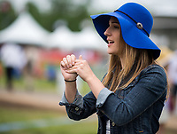 BALTIMORE, MD - MAY 20: A woman looks on while in the infield on Preakness Stakes Day at Pimlico Race Course on May 20, 2017 in Baltimore, Maryland.(Photo by Scott Serio/Eclipse Sportswire/Getty Images)