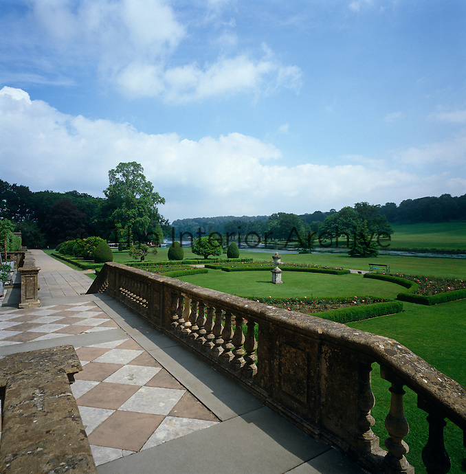 View over a stone balustrade from the steps leading down to the formal garden at Longleat