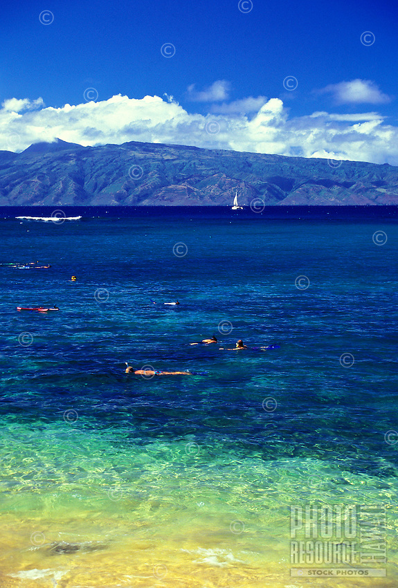 Kapalua Bay with Molokai in background on a clear day with people snorkling