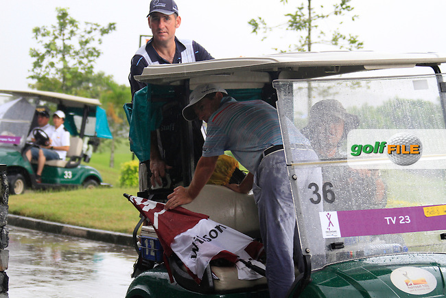A very wet Steve Webster (ENG) gets a lift back to the clubhouse as the heavens open yet again as monsoon rains fall during Saturday's storm delayed  Round 3 of the Iskandar Johor Open 2011 at the Horizon Hills Golf Resort Johor, Malaysia, 19th November 2011 (Photo Eoin Clarke/www.golffile.ie)