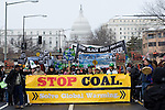 Capitol Climate Action.March 2, 2009  Capitol Coal Plant, Washington, D.C, USA.<br /> A symbol of the strangle-hold that fossil fuels have on our economy, protestors march in front of the Capitol Coal Plant in Washington DC. The protesters were calling for clean renewable energy. Two days before the planned protest, the US government announced that the plant would be converted to Natural Gas. Organizers cited this news as a partial, but incomplete victory - as Natural Gas is still a fossil fuel - and vowed to take on coal plants across the country.