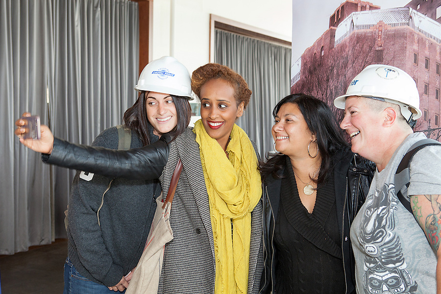 Female construction workers in hard hats at the NoVo Foundation's Women's Building announcement in NYC, October 26, 2015