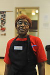 Rosetta serves school lunch in the cafeteria at Nathanael Greene Elementary School in the McKinley Park neighborhood in Chicago, Illinois on December 19, 2014.  Rosetta has worked in the cafeteria at Nathanael Greene for ten years.