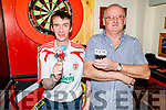 Martin Lacey and Thomas Casey throwing darts for the Motor Neurone fundraising darts competition in memory of Peter O'Sullivan in Turners Bar on Sunday.