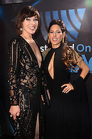 LOS ANGELES, CA - NOVEMBER 20: Milla Jovovich, Kerri Kasem at Westwood One on the carpet at the 2016 American Music Awards at the Microsoft Theater in Los Angeles, California on November 20, 2016. Credit: David Edwards/MediaPunch