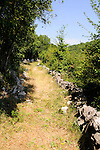 Wanderweg rund um Omisal; Hiking-path around Omisalj. Krk Island, Dalmatia, Croatia. Insel Krk, Dalmatien, Kroatien. Krk is a Croatian island in the northern Adriatic Sea, located near Rijeka in the Bay of Kvarner and part of the Primorje-Gorski Kotar county. Krk ist mit 405,22 qkm nach Cres die zweitgroesste Insel in der Adria. Sie gehoert zu Kroatien und liegt in der Kvarner-Bucht suedoestlich von Rijeka.