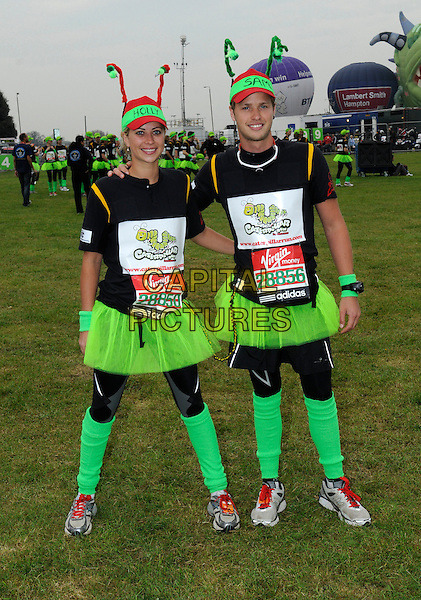 HOLLY & SAM BRANSON .Celebrities take part in the Virgin London Marathon 2010, London, England, UK, 25th April 2010..full length brother sister siblings family black green tutu leg warmers hat cap names team caterpillar arm around arms costume .CAP/DH.©David Hitchens/Capital Pictures.