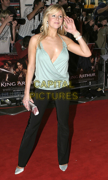 """ABI TITMUSS.""""King Arthur"""" UK Premiere, Leicester Square. London,.15th July 2004..full length blue green vest top low cut plunging neckline silver clutch bag.Ref: AH.www.capitalpictures.com.sales@capitalpictures.com.©Capital Pictures."""