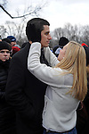 "A young couple waits for the ""We Are One"" concert to start in the cold in celebration of Barack Obama's inauguration as president of the United States at the Lincoln Memorial in Washington DC on January 18, 2009."