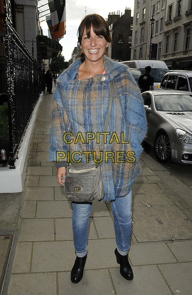 Davina McCall.The Very.co.uk s/s 2013 catwalk show, Claridge's Hotel, Brook St., London, England..September 13th, 2012.full length blue beige plaid tartan mohair top jeans denim grey gray satchel bag purse hand in pocket smiling black boots .CAP/CAN.©Can Nguyen/Capital Pictures.