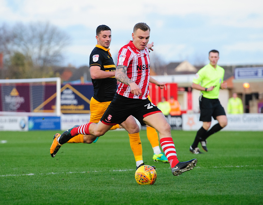 Lincoln City's Harry Anderson scores his side's second goal<br /> <br /> Photographer Chris Vaughan/CameraSport<br /> <br /> The EFL Sky Bet League Two - Lincoln City v Newport County - Saturday 22nd December 201 - Sincil Bank - Lincoln<br /> <br /> World Copyright © 2018 CameraSport. All rights reserved. 43 Linden Ave. Countesthorpe. Leicester. England. LE8 5PG - Tel: +44 (0) 116 277 4147 - admin@camerasport.com - www.camerasport.com