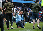 Jubilant Manchester City fans invade the pitch on the final whistle during the premier league match at the Etihad Stadium, Manchester. Picture date 22nd April 2018. Picture credit should read: Simon Bellis/Sportimage