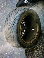A hot rain tire steams on pit road after coming off a car during the Rolex 24 at Daytona, Daytona INternational Speedway, Daytona Beach, FL, February 4, 2001.  (Photo by Brian Cleary/www.bcpix.com)