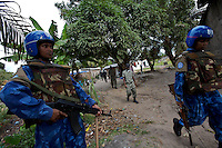 Indian female Peacekeepers from the Indian FPU ( formed police unit ) provide armed  support to the liberian national police ( in the background )during a cordon and search operation in the  in Monrovia, Liberia on Monday March 19 2007. .103 Indian police personnel  were specially selected to take part in the UNMIL peacekeeping mission in Liberia for an initial deployment of 6 months. .They are the first contingent entirely formed by women in the history of the United Nations Peacekeeping..their mission in the country is to provide fire support to the unarmed liberian security forces. In india these women distinguished themselves by operating in the most troubled areas of the country taking part in counter insurgency and crowd control special operations.