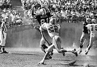 Oakland Raiders Warren Wells grabs pass against #22 Zeke Moore of the Houston Oilers. (1969 photo/Ron Riesterer)
